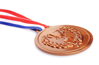 Medalha de bronze dada a terceiro lugar em competições